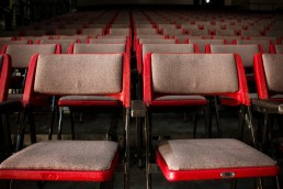 rows of empty theatre seats